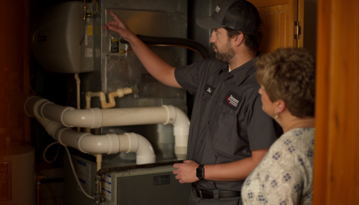 Bensons Tech Looking At Furnace With Customer