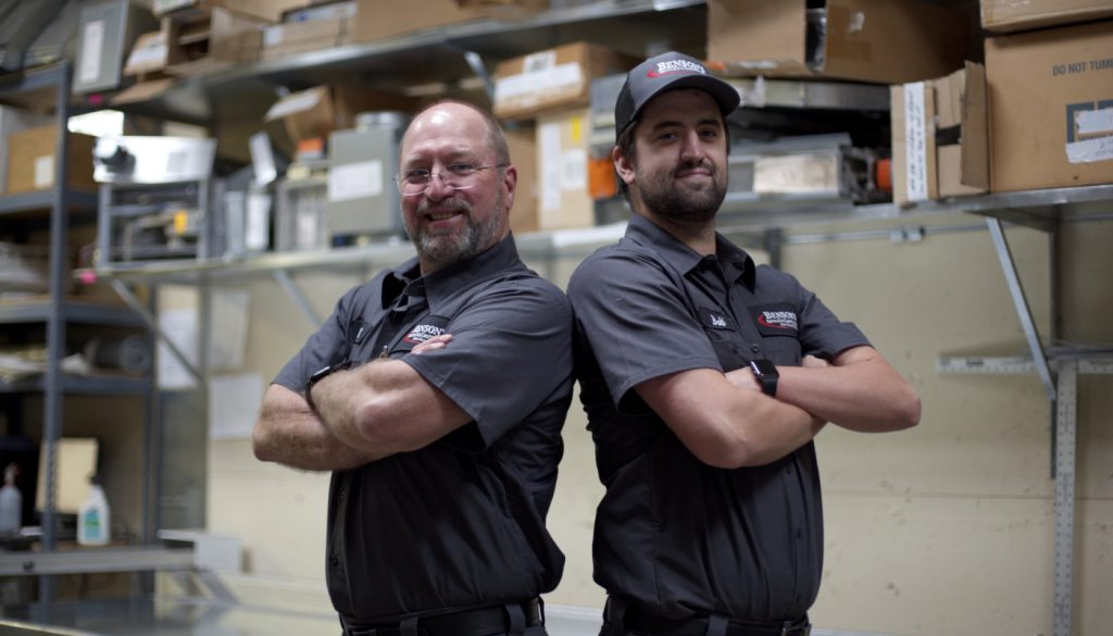 Bensons Technicians In Warehouse Smiling@2x